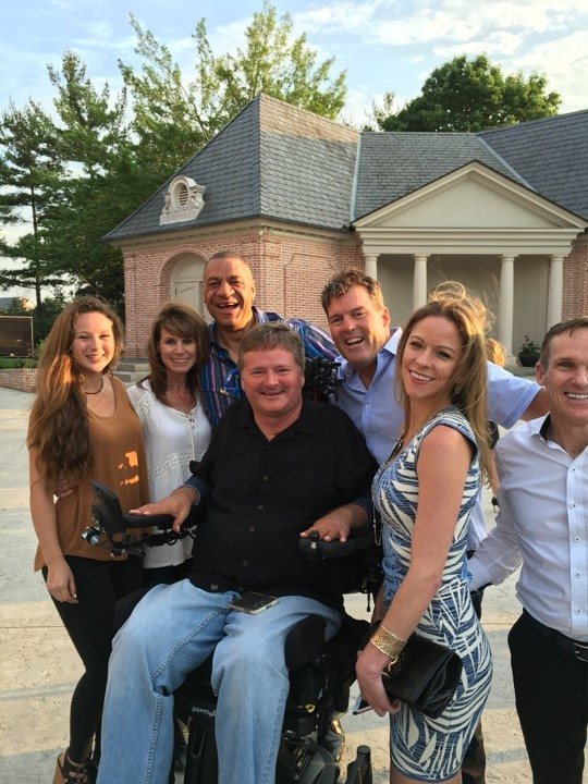 Sam Schmidt, surrounded by his family, Rick Nelson, and Headley Chambers